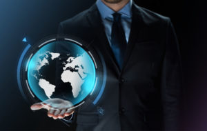 Business Virtual Reality People And Future Technology Concept Close Up Of Businessman In Suit With Earth Projection On Hand Over Dark Background